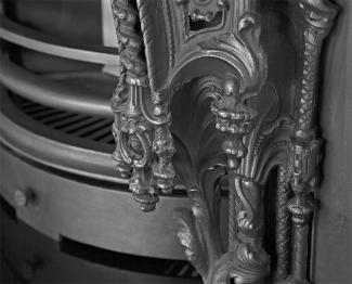 The Rococo Arched Cast Iron Fireplace Insert bars detail